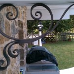 Forged and acid blackened stainless steel decorative support
