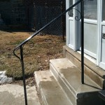Outside post and handrail design with forged scrolls